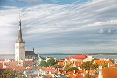 View of Tallinn Old Town, Baltic Sea and St. Olaf in a summer day, Estonia. Aerial View of Tallinn Old Town, Baltic Sea and St. Olaf in a summer day, Estonia Royalty Free Stock Image