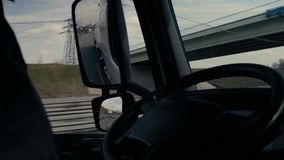 View in tank car`s rearview mirror on highway. Passenger point of view in the tank car`s rearview mirror on the highway near Moscow. POV stock video footage