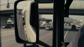 View in tank car`s rearview mirror on highway. Point of view in the tank car`s rearview mirror on the highway in Moscow. POV stock video