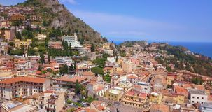 View of Taormina - famous resort in Sicily. Italia. Beautiful aerial travel landscape with the old town from above stock footage