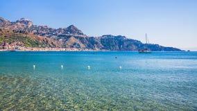 View of Taormina town and Giardini Naxos resort. Travel to Italy - view of Taormina town on mountain of Cape Taormina and Giardini Naxos resort on the coast of stock photos