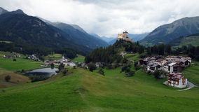View of Tarasp (Graubunden, Switzerland). Tarasp is a gorgeous village in the canton of Graubünden, Switzerland. It is dominated by the famous castle Tarasp Stock Photography