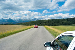 A view of the Tatra Mountains and highway in summer Stock Photo