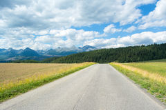 A view of the Tatra Mountains and highway in summer Royalty Free Stock Images