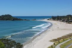 View of Tauranga from Mount Maunganui in New Zealand. The surf rolls on to the perfect sandy beach stock photos