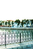 View from Tavira Bridge. View of a bridge railing and historic town in background Stock Photo