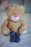 View of teddy bear and baby socks Royalty Free Stock Photo