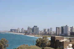 The view of Tel aviv beach from Jaffa. On a sunny bright day Stock Images