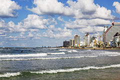 View of tel Aviv and the Mediterranean coast with surfers, Royalty Free Stock Photo