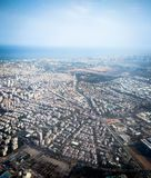 View of Tel Aviv and the Mediterranean Sea from window of plane taking off from airport Ben Gurion Stock Photos