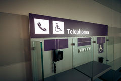 View of telephones in airport terminal Stock Photography