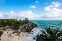 View of the Temple God of Winds at Tulum with the Caribbean Sea in the background. Mayan Ruins of Tulum, Yucatan Peninsula, Mexico royalty free stock photography