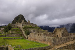 View of temple ruins in Lost Inca City of Machu Picchu. Low clou Stock Photography