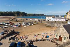 View from Tenby harbour and beach Pembrokeshire Wales uk in summer with tourists and visitors and blue sky Stock Image