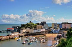 View of Tenby Harbour, with Castle Hill. Picturesque view of boats in Tenby Harbour, with its clusters of colourful painted houses, and Castle Hill Royalty Free Stock Photos