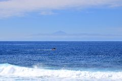 View of Tenerife island with the volcano Teide with the Atlantic Ocean in between royalty free stock image