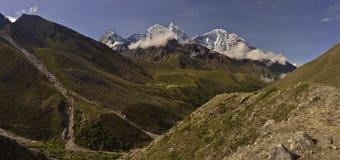 View of Tengboche monastery with mountains background. Nepal 2015. Panormaic view of Tengboche (3,867m) with background mountains Thamserku: 6608m, Kangtega Stock Photos