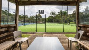 View of a tennis court from a player`s hut next to the court royalty free stock photography