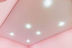 A view of tension mat ceiling and spot lights in it. A view of the tension mat ceiling and spot lights in it Royalty Free Stock Photography