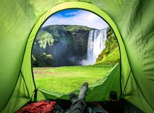 View from tent and Skogafoss waterfall in summer, Iceland. Europe Stock Photo