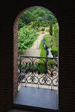 View at the terrace through an ornamental fencing Stock Photo