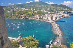The view from the terraces of the Aragonese castle on Ischia isl. And, a magnificent Bay with the ships and the bridge on a clear Sunny day Royalty Free Stock Photos