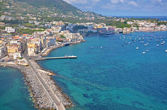 The view from the terraces of the Aragonese castle on Ischia isl. And, a magnificent Bay with the ships and the bridge on a clear Sunny day Stock Photography