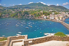 The view from the terraces of the Aragonese castle on Ischia isl. And, a magnificent Bay with the ships and the bridge on a clear Sunny day Stock Photo