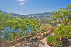 The view from the terraces of the Aragonese castle on Ischia isl. And, a magnificent Bay with the ships and trees on a clear Sunny day Royalty Free Stock Image