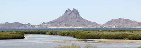 A View of Tetakawi Peak Rising Above San Carlos, the Sea of Cortez and Soldado Estuary. In Sonora, Mexico stock photography