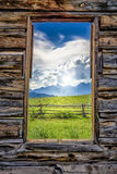 View of the Tetons Through a Cabin Window Royalty Free Stock Photo