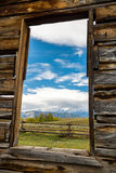 View of the Tetons Through a Cabin Window Stock Images