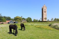 View on the 13th century church tower in Firdgum Royalty Free Stock Photo