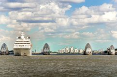 View of the Thames Barrier on a cloudy day under blue sky in London. The Thames Barrier is one of the largest movable flood barriers in the world protecting stock images