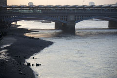 View of the Thames at dusk. Low tide Stock Image