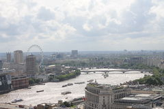 View on the Thames and London Eye from the Saint Paul Cathedral. View on the Thames, London Eye and the city from the Saint Paul Cathedral in London royalty free stock photography