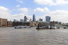 View on Thames river and modern glazed office buildings, London, United Kingdom. LONDON, UNITED KINGDOM - JUNE 22, 2017: View on Thames river and modern glazed Royalty Free Stock Photo