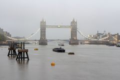 View from the Thames river of the Tower bridge in deep morning fog. London, the UK royalty free stock images