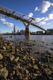 View from the Thames Shore in London. London, UK - January 28th 2019: A view from the shore of the River Thames in London, UK. This view takes in the sights of stock photos
