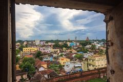 View of Thanjavur city from the palace window. Thanjavur, formerly Tanjore, is a city in the south Indian state of Tamil Nadu. Thanjavur is an important center Royalty Free Stock Photo