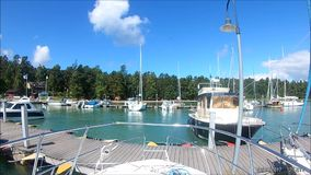 A view we think quite common in Nauvo,  in small marinas in Finland. Nice view in filnnish small marina called Nauvo  near by Turku, in the Gulg of Finland stock footage