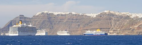 Cruise Ships moored near Thira on the Greek Island of Santorini royalty free stock photo