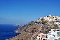 View of Thira Fira on the island of Santorini. Greece. Fira is the capital of Santorini: this small village with the characteristic alleys dominated by white and Stock Photos