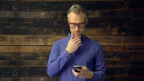 Thoughtful man using phone device stock video footage