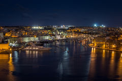 View of the three cities by night in Malta. View from Valletta on the three cities in Malta Royalty Free Stock Photo