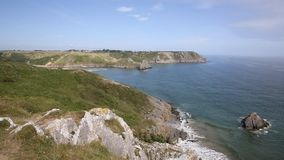 View of Three Cliffs Bay the Gower Peninsula Swansea Wales uk from the west stock video footage