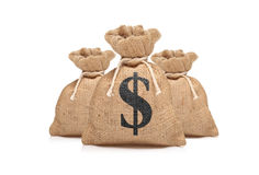 A view of three money bags with US dollar sign. Against white background Stock Photo