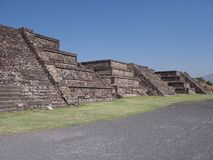 View of three stony pyramids at Teotihuacan ruins seen from Avenue of the Dead near Mexico city landscape. S with clear blue sky in 2018 warm sunny winter day stock photo