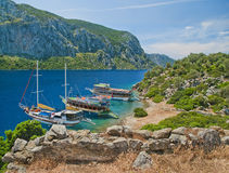 View of three tourist boats at island from medieval wall ruins Stock Photos