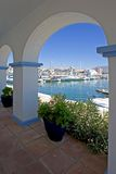 View Through Arch To Duquesa Port And Mountains Stock Image